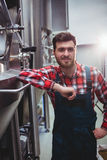 Male manufacturer standing in brewery Royalty Free Stock Image