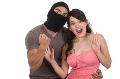 Male masked thief holding young girl Stock Images