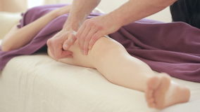 Male massage therapist does foot massage for women, hips, anti-cellulite massage