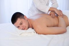 Male masseur doing massage back spa health. Male massage therapist does the procedure Massage Spa health Royalty Free Stock Image