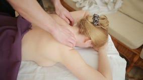 Male massage therapist doing back massage to woman. Massage specialist massaging woman s back at beauty salon. Male massage therapist doing back massage to woman stock video