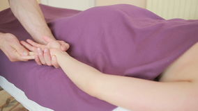 Male massage therapist doing hands massage to woman.  stock footage