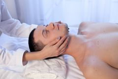 Male masseur doing massage health spa procedure. 1 Royalty Free Stock Images