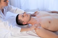 Male masseur doing massage in the Spa. 1 Royalty Free Stock Photo