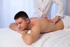 Male masseur doing massage in the Spa. 1 Stock Photos