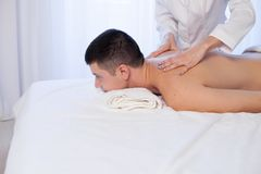 Male masseur makes therapeutic massage in the Spa. 1 Stock Photography