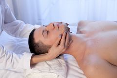 Male masseuse makes a therapeutic massage. In the Spa Royalty Free Stock Photography