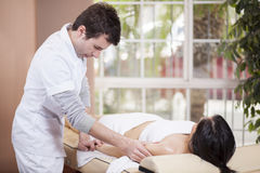 Male masseuse at work Royalty Free Stock Photo