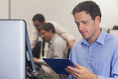 Male mature student working with a tablet Stock Image