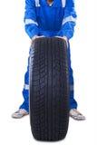 Male mechanic changing a tire Stock Photo
