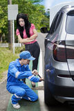 Male mechanic help his client on the street Stock Images