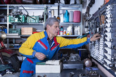 Male mechanic at his workshop Royalty Free Stock Image