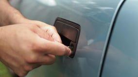 Male Mechanic Holding Lockpicker To Open Car Door. Close up stock footage