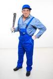 Male mechanic holding monkey wrench on white Stock Photo