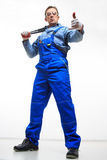 Male mechanic holding monkey wrench on white Royalty Free Stock Photos