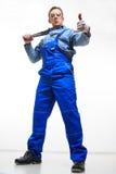 Male mechanic holding monkey wrench on white Royalty Free Stock Photos