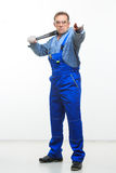 Male mechanic holding monkey wrench on white Stock Photos