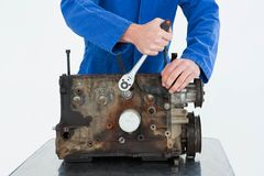 Male mechanic repairing car engine Royalty Free Stock Photography