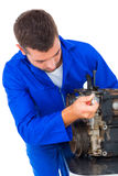 Male mechanic repairing car engine Stock Image