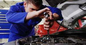 Male mechanic servicing a car stock video