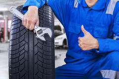 Male mechanic showing thumb up in workshop Royalty Free Stock Photo