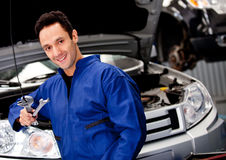 Male mechanic smiling Stock Photos
