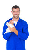 Male mechanic wiping hands with cloth Stock Images