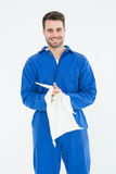 Male mechanic wiping hands with cloth Stock Photos