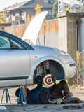 Male mechanic working under car Royalty Free Stock Photo