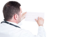 Male medic cardiologist reading ekg cardiogram paper Stock Image