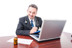 Male medic at office smiling and writing on clipboard. Isolated on white background Royalty Free Stock Images