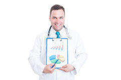 Male medic showing clipboard with graphics. Male medic smiling and showing clipboard with graphics isolated on white background Stock Photography