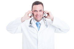 Male medic  speaking at two telephone as being busy Stock Photography