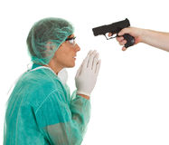 Male medical doctor and gun Royalty Free Stock Images