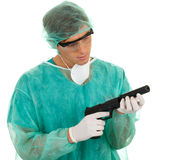 Male medical doctor and gun Stock Images