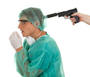 Male medical doctor and gun Royalty Free Stock Photography