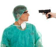 Male medical doctor and gun Stock Photos