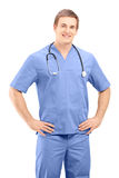 A male medical practitioner in a uniform posing Stock Image