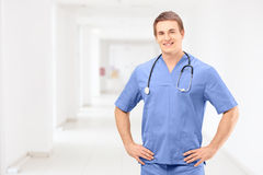 A male medical practitioner in a uniform posing in a clinic Stock Photo