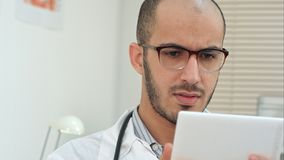 Male medical worker using digital tablet stock photography