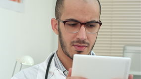 Male medical worker using digital tablet stock footage