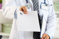 Male medicine doctor hand hold clipboard pad and give prescripti Royalty Free Stock Image