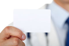 Male medicine doctor hand holding blank calling card Royalty Free Stock Photos