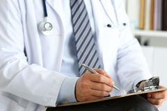 Male medicine doctor hand holding silver pen writing Royalty Free Stock Images