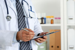 Male medicine doctor hand holding silver pen writing Royalty Free Stock Photography