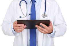 Male medicine doctor holding black digital tablet pc. Medical equipment, modern technology and communication concept. Therapeutist using portable computer Royalty Free Stock Image