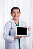Male medicine doctor holding digital tablet pc and showing scree. N to camera Stock Photos