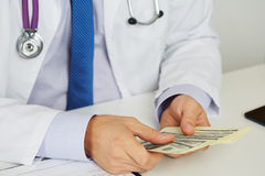 Male Medicine Doctor Holding In Hands Bunch Of Hundred Dollars B Royalty Free Stock Photography
