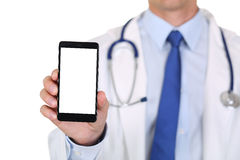 Male medicine doctor holding mobile phone Royalty Free Stock Images