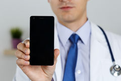 Male medicine doctor holding mobile phone Royalty Free Stock Photo